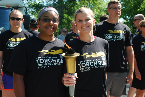 Torch bearers participate in the final leg ceremony.